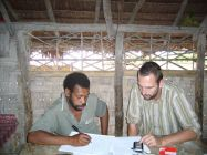 Stefan Schnell with George T. Atkins working on transcriptions and translations.