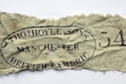 Scrap of cotton found at Hyde Park Barracks, artefact number UF4713