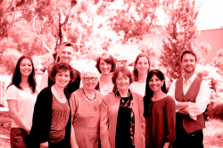 outside, with greenery background, in red filtered image of the olga tennison autism research centre team