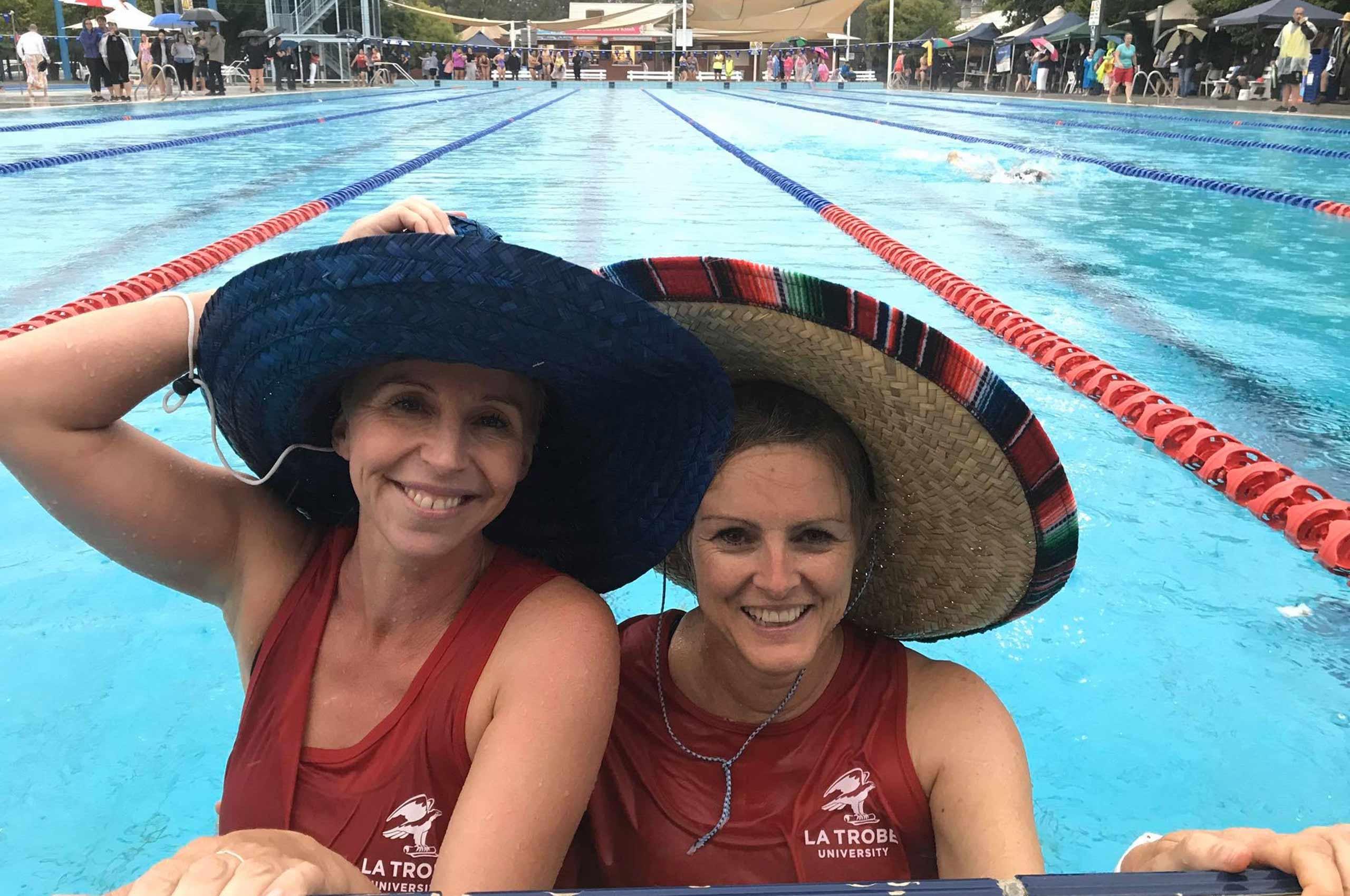 Two women in a swimming pool.