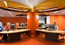 Image of ASK La Trobe Help Zone in Bundoora. Orange room with three people sitting at desks